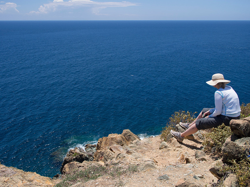 next coastline:  Africa<br /> Elaine takes it all in atop Ram Head Point<br /> <br /> St. John, USVI<br /> March 2013