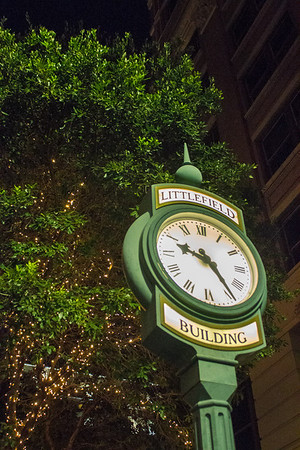 The Littlefield Building's clock on the sidewalk.
