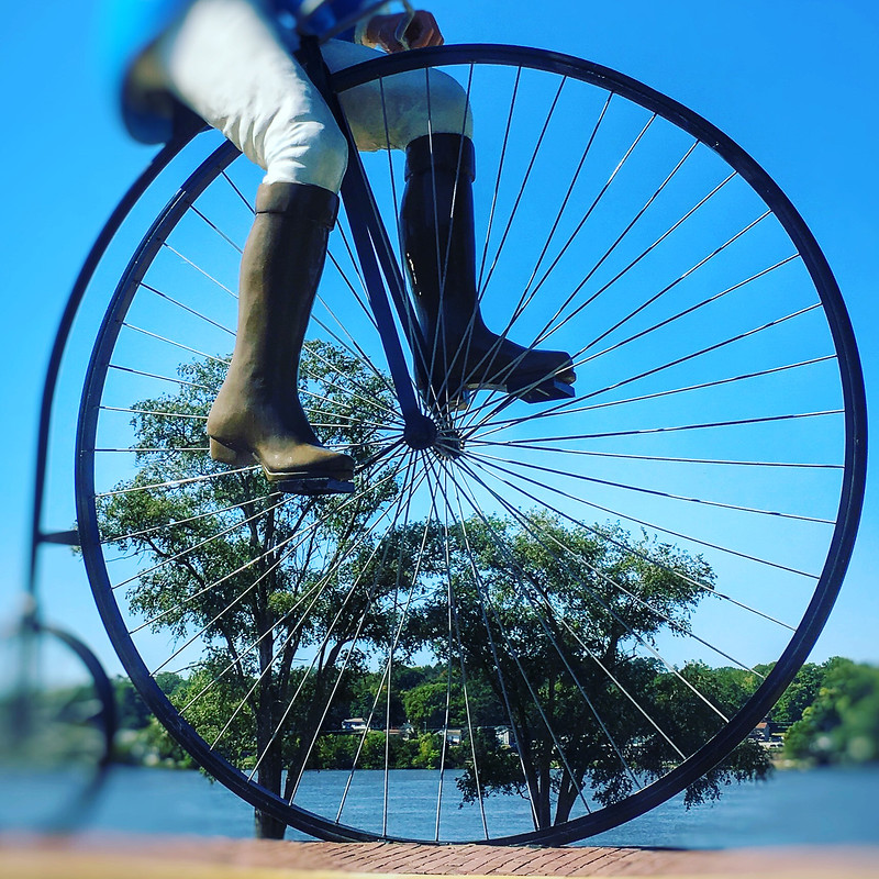 Closeup of wheel of bicycle statue.