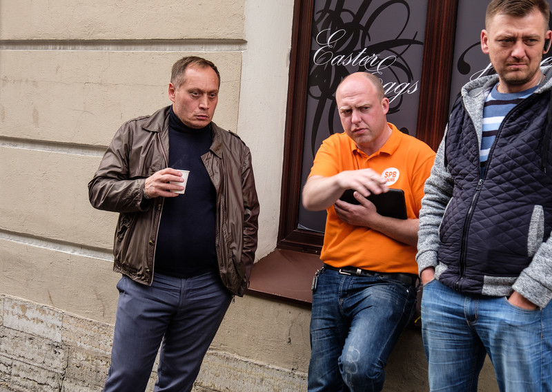 Bus drivers on break (our guy in orange). Guy on left looks like Putin.