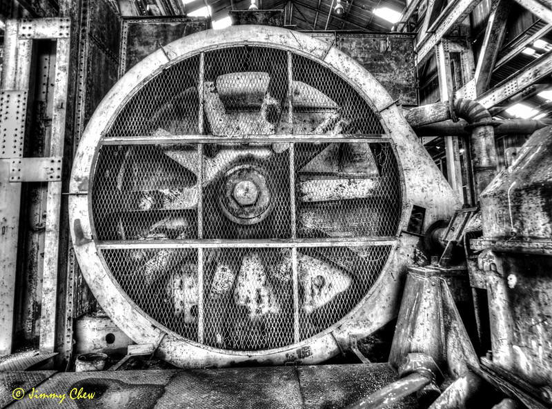 "Dredge flywheel(?) <br /> <br /> Higher-res pic here: <a href=""http://www.jimmychew.com/Places/20171211-Dredge/i-nJ4VQ4j/A"">http://www.jimmychew.com/Places/20171211-Dredge/i-nJ4VQ4j/A</a><br /> <br /> #HDR #industrial #blackandwhite #monochrome #architectural #iphone #tonemapping"