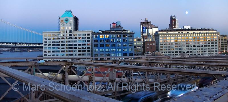 Moon over Manhattan on the Brooklyn Bridge, Photographed at: Sunset on the Brooklyn Bridge, Brooklyn, NY. October, 2006  ©2006 Marc Schoenholz