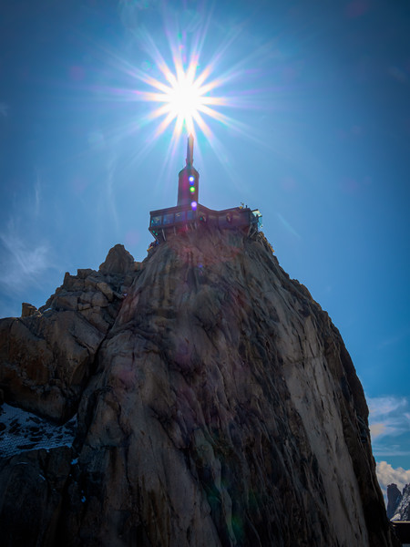 Sun burst on the tip of tower at top of Mount Blanc