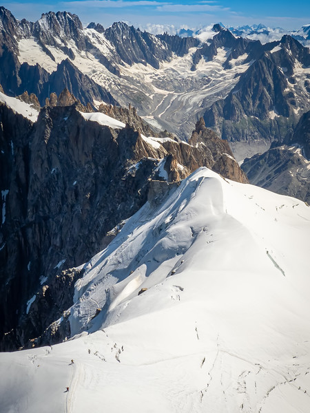 Mount Blanc. Climbers can be seen as small dots in the lower left of photo