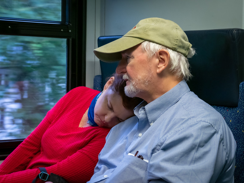 Joni & Tommy on the train. Travel is hard work!