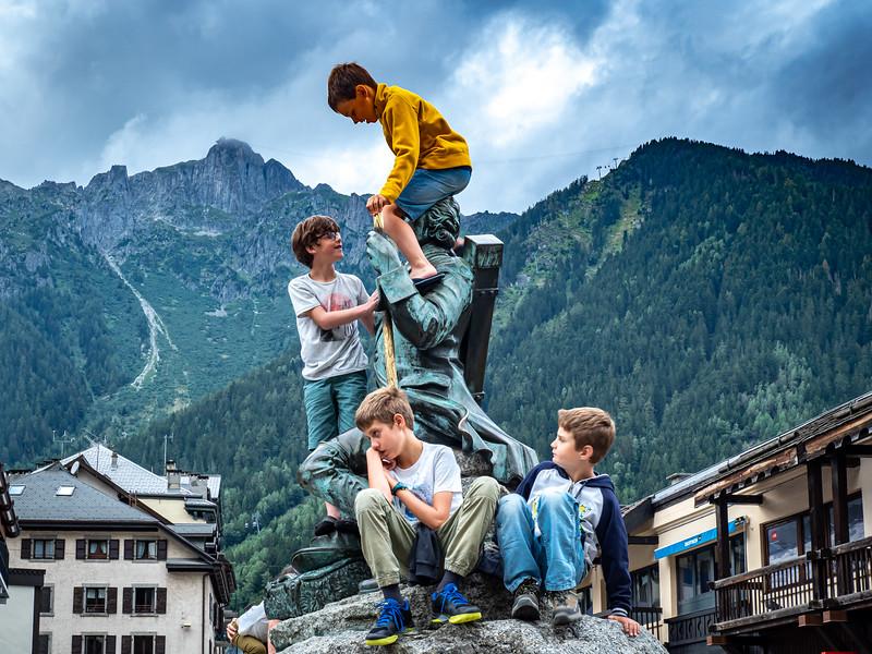 Kids climbing statue in Chamonix
