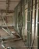 An interior wall partially torn apart