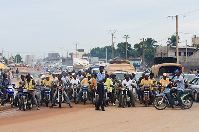 Click here to buy at Alamy. Keywords: Africa Benin Cotonou Motorbike Street Transport MyID: 09AZa5262