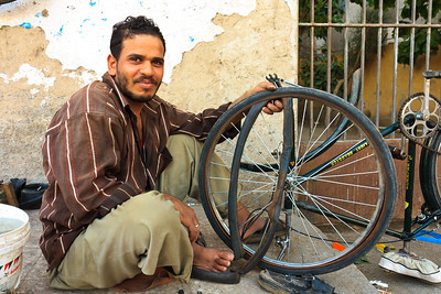 Click here to buy at Alamy. Keywords: Africa Assiut Bike Egypt Mechanics Workshop Men MyID: 09AZa11235