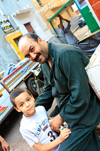 Click here to buy at Alamy. Keywords: Africa Egypt Kids Streets Younger Men Zagazig 2009 MyID: 09AZa11982