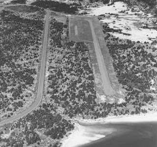 Construction of the runway left several hundred feet of land between the south end of the tarmac and the shore of the bay. This image from 1978 shows trees growing on that land and throughout the rest of the park.