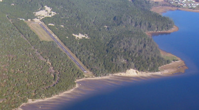 In the 1980s, park staff removed the trees from the south end of the air strip to improve the angle of approach for air craft. Removing the trees allowed the bay to erode the land to bring water close to the tarmac.