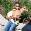 Little girl and her pet goat in the parking lot