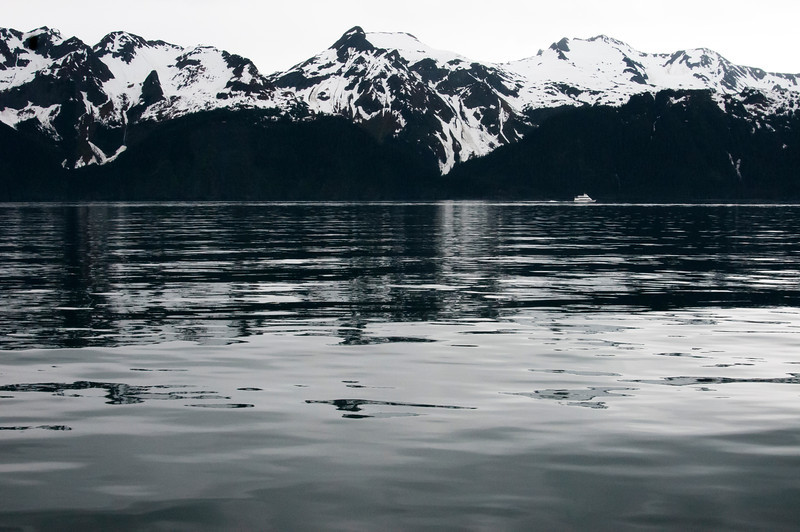 Kenai Fjords, Alaska, with a tourist boat in the far distance.