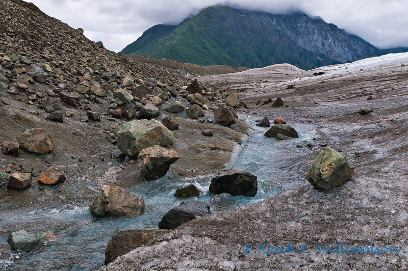 Glacier debris and stream, on the Root Glacier