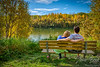 Enjoying a park bench in autumn