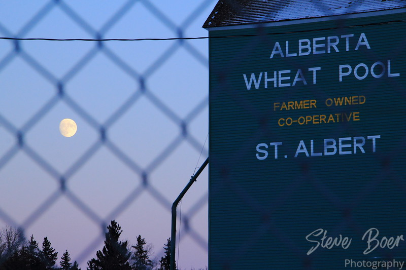 Moon and grain elevator with fence