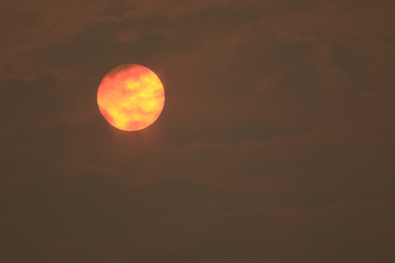 Smoky cloudy sun setting