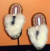 Fur lined beaded moccasins.