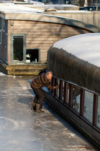Early Spring Cleaning  Ever pragmatic, houseboat owners took full advantage of the ice