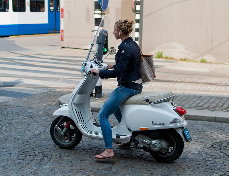 Girl on scooter in Amsterdam