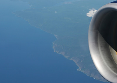Somewhere over the nortwest Pacific rim, heading for Beijing. Possibly the southwestern coast of Korea.