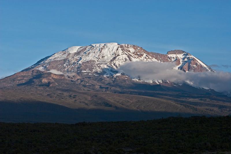 Approaching sunset. Kilimanjaro peak. Day two hike. Shira Camp 1.