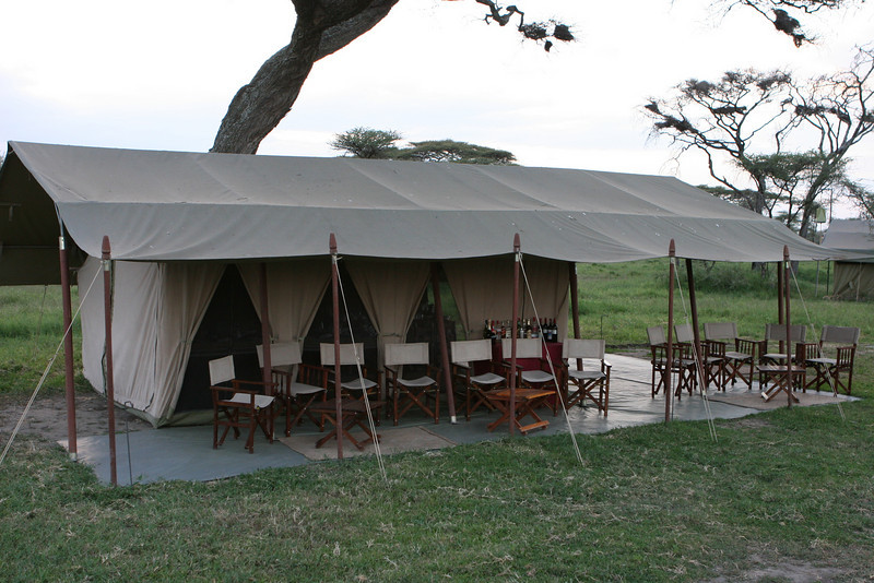 "OK, we can do this. The main dinner tent. Complete with bar. <a href=""http://www.serengetisavannahcamps.com/"">http://www.serengetisavannahcamps.com/</a>"