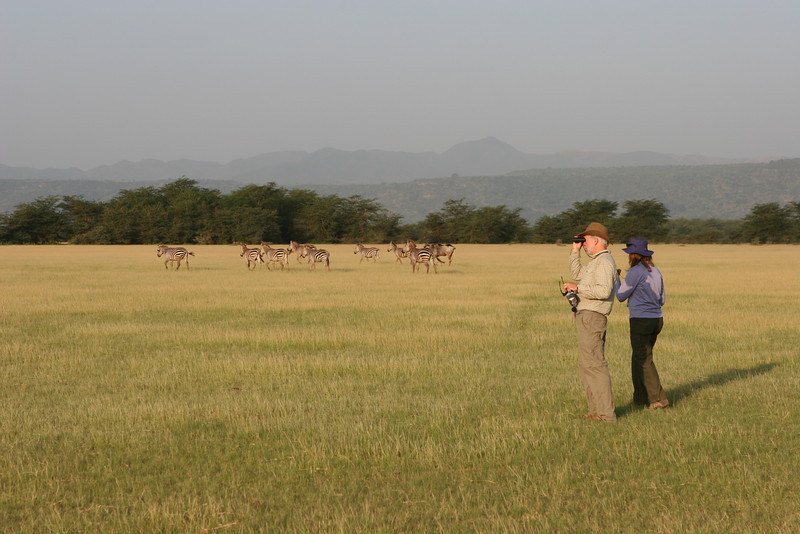 The plains east of the Migunga Forest Camp and Lake Manyara National Park. L-R: Zebras, Dan, Heather.