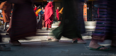 A monk watches pilgrims circulate the Memorial Stupa in Thimphu