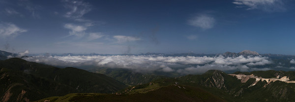 Above the Clouds, Sichuan Province  The view from the 4,000m Xiaobaodeng Pass on the road from Ziuzhaigou to Huanglong.