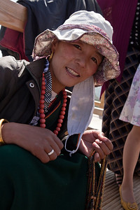 Jewelry Vendor, Xuebaoding Pass  The jewelry vendor has a smile on he face after the deal has been sealed.