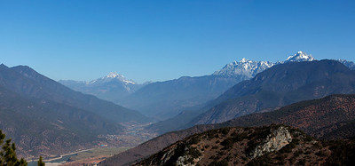 Triple Trio, Yunnan   Haba Snow Mountain (centre left), Jade Dragon Snow Mountain (right), the Yangtse (foreground).