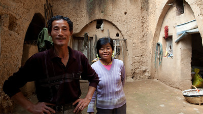 16. Farmer and his wife outside their cave, Xiekou, Shaanxi
