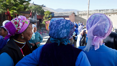Headscarves  The blue and pink headscarves of the Bai women bring colour to the streets of Xizhou.