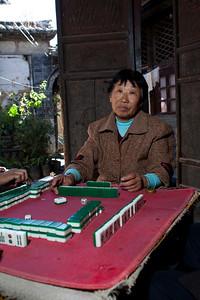 Li Yu Lian  76 year old Li Yu Lian at the courtyard mahjong table.  Off camera flash with mini softbox