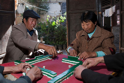 The Mahjong Game 2  Brian Linden took me to this hidden courtyard to photograph these locals at their afternoon mahjong game.  The lighting was tough, dark inside with bright afternoon sun streaming through the open doors.  Off camera flash with mini softbox