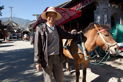 Mr Yang and his horse  43 year old Yang Biao Qi is one of numerous horse and cart drivers who transport people between the villages.  He took us to the shores of Erhai Lake to see the fishermen.   Natural light