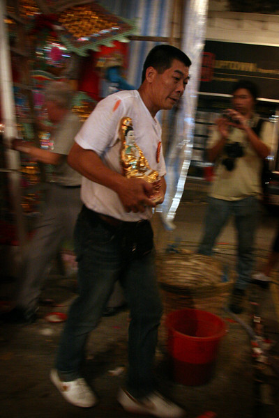 The god is taken back to the safety of the village hall before Taai Si Wong is beaten, burnt and sent back to hell