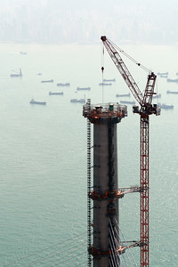 The West Tower and tower crane high above Hong Kong's harbour.