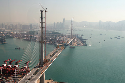 Stonecutters Bridge looking towards Kowloon.  Taken through the wind shield of the helicopter so a bit of reflection.