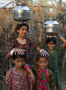 Girls coming back from the village water pump