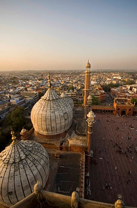 Sunset on the domes of the mosque from top of the minaret.
