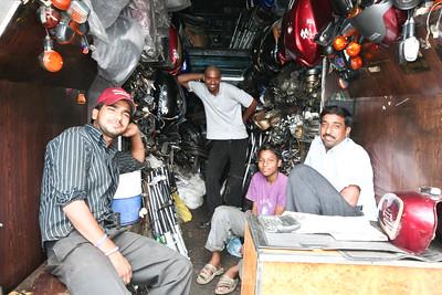 06IP098 Car Parts Bazaar Delhi Full Body Groups India Markets Mechanics Mechanics' Motor Market Occupations Old Delhi Portraits Streetlife Streets Work Workshops Younger Men