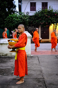Waiting for morning alms collection, Wat Syrimoungkoun Xaiyaram, Luang Prabang