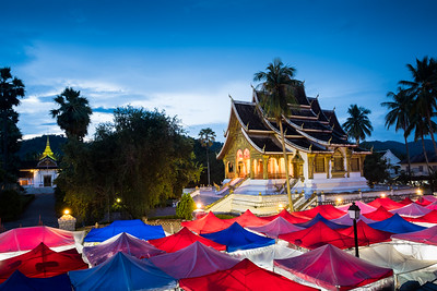 Haw Pha Bang Temple above the Night Market at Dusk, Luang Prabang
