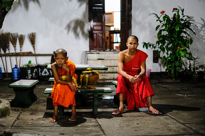Waiting to be called for morning alms collection, Wat Syrimoungkoun Xaiyaram, Luang Prabang