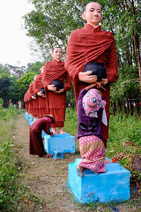 Ladies Painting the 500 Disciple Statues, Mawlamyine