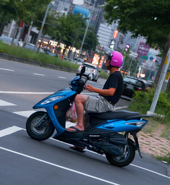 one guy, on a scooter