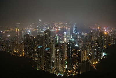 the skyline of hong kong during the rain season as seen from the hills on hongkong island. Kowloon and the harbour area are seen in the back.